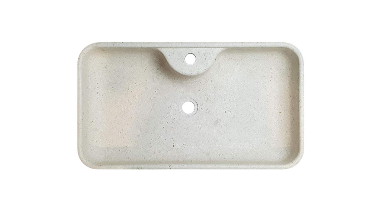 lavandino in marmo con sede rubinetteria